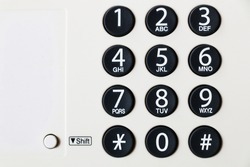 Close-up of dial number button on old used telephone and fax