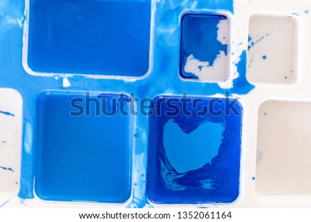 Close up of different color oil paint, Patterns or backgrounds of various colors, colors on the fabric.  #1352061164