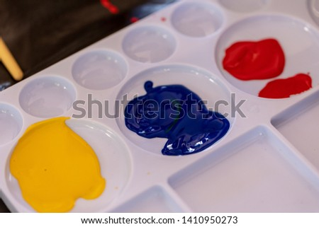 Close up of different color oil paint, Patterns or backgrounds of various colors, colors on the fabric.  #1410950273