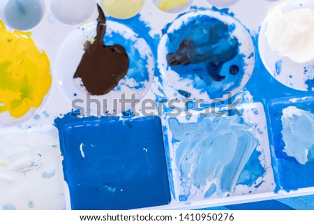 Close up of different color oil paint, Patterns or backgrounds of various colors, colors on the fabric.  #1410950276