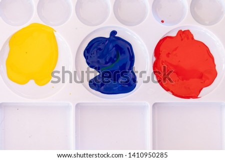 Close up of different color oil paint, Patterns or backgrounds of various colors, colors on the fabric.  #1410950285