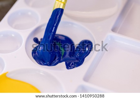 Close up of different color oil paint, Patterns or backgrounds of various colors, colors on the fabric.  #1410950288