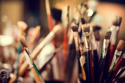 Close up of different painting brushes in paiter's atelier