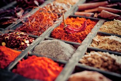 Close-up of different types of Assorted Spices in a wooden box.
