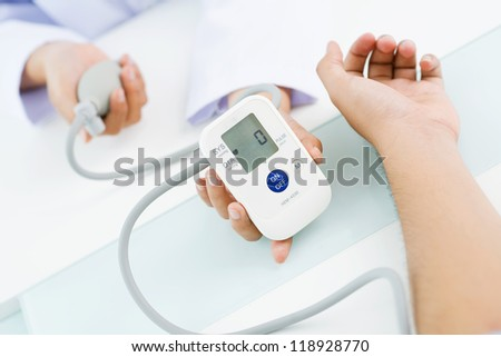 Close-up of digital screen of blood pressure gauge