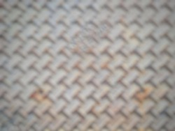 Close up of dirty and rusty metal manhole surface blurred background