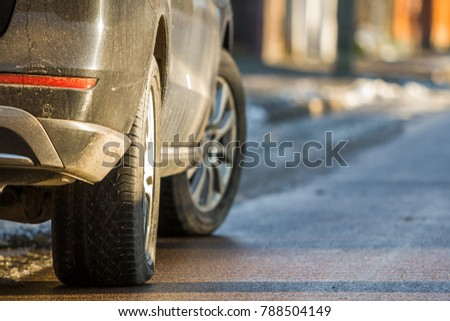 Close-up of dirty car parked on a side of the street #788504149