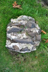 Close Up of Discarded Lump of Concrete & Stone in Old Cemetery