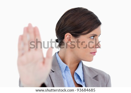 Close up of dismissive female entrepreneur against a white background