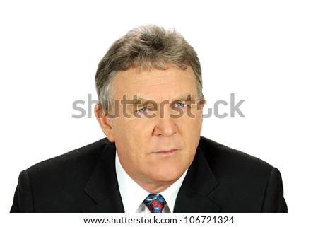 Close up of distrusting middle aged businessman looking at camera.