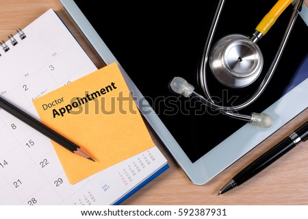 Close up of doctor appointment, stethoscope book and pen on calendar. Booking reminder plan for doctor appointment.