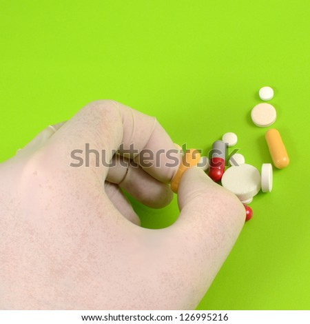 Close up of doctor hand taking pill