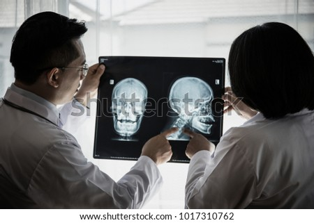 Close up of doctor holding x-ray, x-ray film of patient at hospital. #1017310762