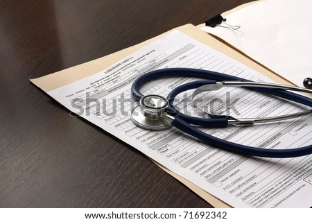 Close up of doctor's stethoscope and patient's medical information.