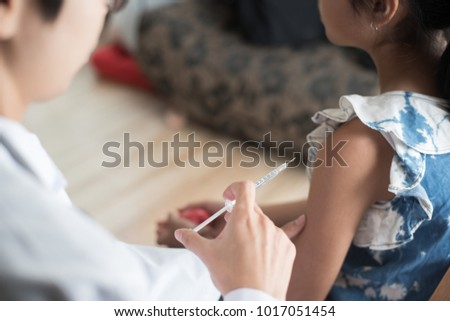 Close up of doctor vaccinating young girl, Vaccination concept. #1017051454