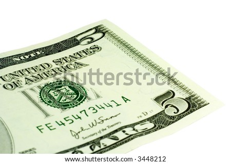 Close-up of 5 Dollar bill isolated on a white background