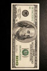 close-up of dollar bills on black background studio