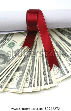 Close-up of dollars and a diploma with red ribbon