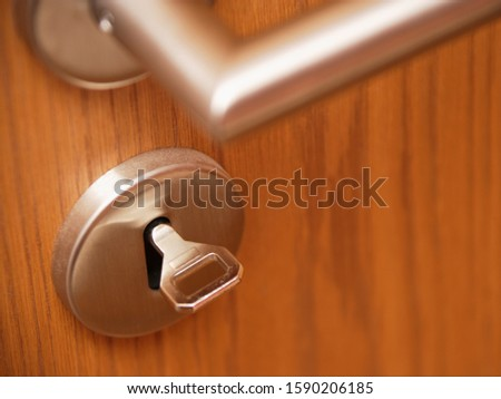 Close up of door handle and key