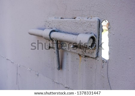 Close up of door locked with iron latch