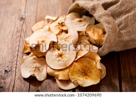 close up of dried apples on wooden table