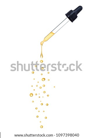 Close-up of dropper with falling drops isolated on white background