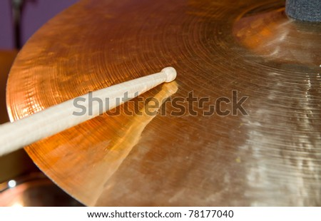 Close up of drum kit with cymbal and drumsticks