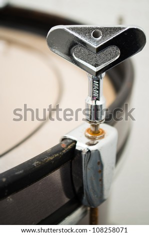 close up of drum tuning key on drum edge
