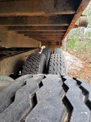 Close up of dump truck tires. Photo shows trucking concept.