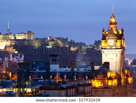 Close up of Edinburgh Castle and Skylines Skyscrapers cityscape and from Calton Hill at dusk Scotland UK