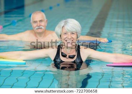 close up of elder couple doing exercises in the pool #722700658