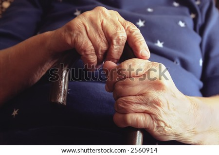 Close-Up of Elderly Woman Holding Cane
