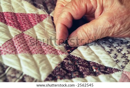 Close-up of Elderly Woman's Hand Busy Quilting