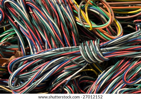 Close-up of electric cables. There is a mix of plastic and copper to recover.