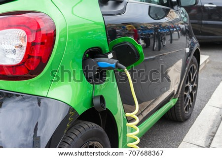Close up of electric car being charging #707688367