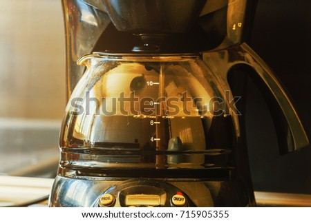 Close-up of electric glass coffee pot with measurer