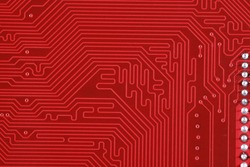 close-up of electronic circuit red board background