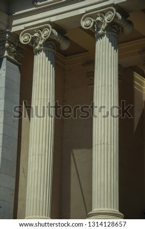 Close-up of elegant columns with Ionic capitals on the west facade of Casón del Buen Retiro, in a sunny day at Madrid. Capital of Spain this charming metropolis has vibrant and intense cultural life.