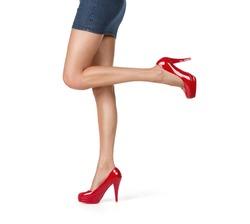 Close up of elegant female legs walking isolated on white background