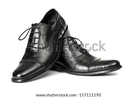 Close-up of elegant men shoes on white background