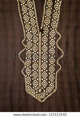 Close up of embroidered neck line on a black moroccan men's robe