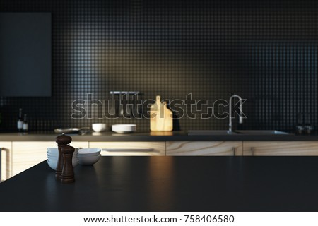 Close up of empty black kitchen counter on blurry interior background. Copy space, 3D Rendering
