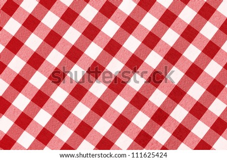 Close up of empty red checkered tablecloth with copy space - stock photo