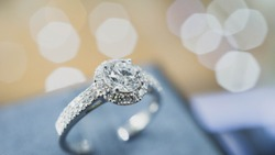 Close up of engagement diamond ring. Love and wedding concept. (soft and selective focus)
