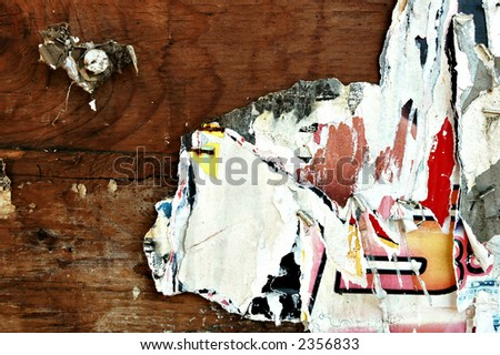 Close up of entertainment event posters torn off a wall