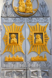 Close-up of entrance door decorated with gilded icons in Trinity cathedral of Holy Trinity-Saint Seraphim-Diveyevo Monastery in Diveyevo, Russia