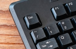 close up of esc button computer keyboard on office desk