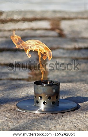 Close up of Eternal Flame at John F. Kennedy's grave in Arlington National Cemetery