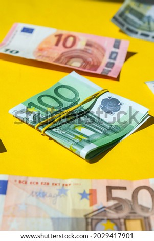 Close up of Euro money roll. Euro banknote set cash money - EU currency. Rolled with rubber euro notes. Business budget of wealth and prosperity finance. Banknotes stacked on each other in different p Zdjęcia stock ©