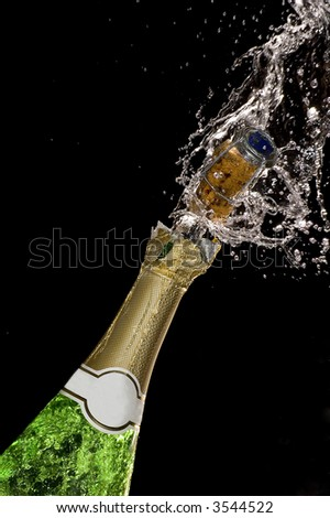 Close-up of explosion of champagne bottle cork #3544522